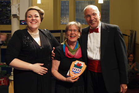 Linda Allan accepting a Choir Plaque on behalf of the Aberdeen Sweet Adelines