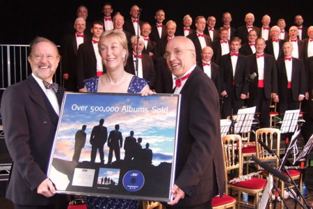 Martyn Jones MP Presenting a Platinum Disk to the Choir marking 500,000 copies of Voices sold in the UK