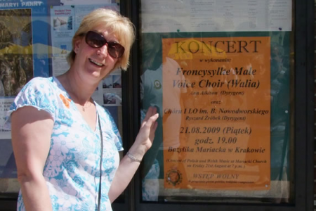 Ann with a poster advertising our Krakow Concert