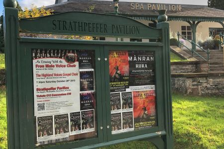 1b. Strathpeffer pavilion the first venue for the choirs mini tour of Scotland proudly displaying a poster for the event