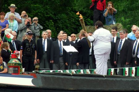 33.The Olympic Torch arrives at Trevor Basin to the strains of We'll Keep a Welcome - 30th May