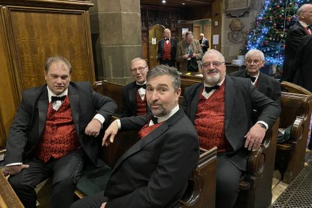 20a. Some of the boys take a PEW before the spirit of Christmas concert at St Giles church with the Ifton Colliery band