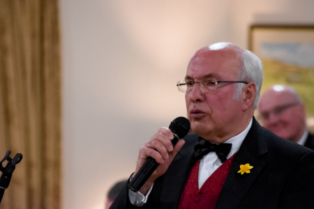 05D. David Jones our Compere recites a poem about Wales whilst the choir sings at our St Davids day Concert at Oswestry Golf Club