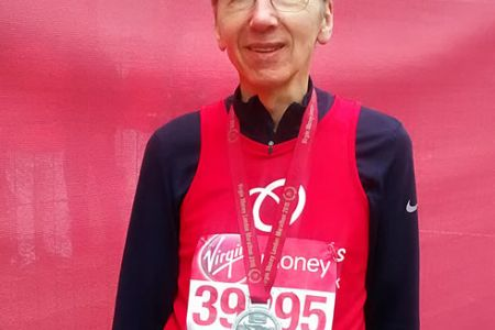 26.Jeff Jones (2nd Tenor) having just completed the 2015 London Marathon and collected his medal - 26th April