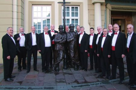 50.The Choir arrive at the Coronation Hall in Ulverston for a concert in aid of St Mary's Hospice and pose with the statue of Laurel and Hardy. Stan Laurel was originally from the Town of Ulverston.