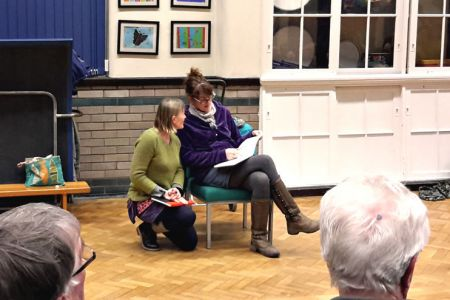 31.Emma Holmes and Carol Davies at Choir practice taking preliminary sketches for a community project Mural for the Froncysyllte Community Centre.