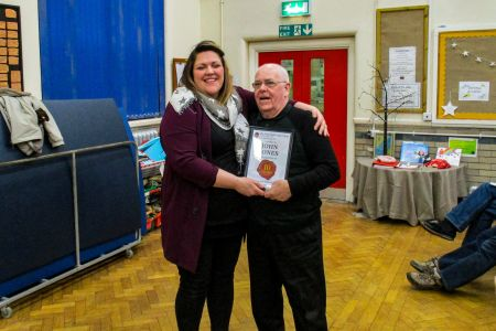 01E. John Jones receives his ten year service award from Leigh Mason the choirs Musical Director at the AGM 31/01/2019