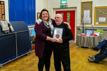 01E. John Jones receives his ten year service award from Leigh Mason the choirs Musical Director at the AGM 31/01/2019