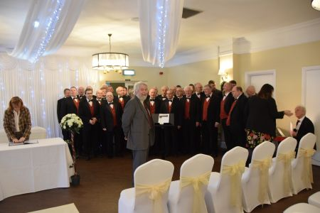 82a. 28/12/19 Jon Haddy with the Choir before the celebrations begin at his Granddaughters Wedding