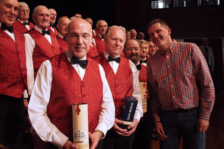 Glen Moray Distillery Manager Graham Coull presents the Choir with some of the finest
