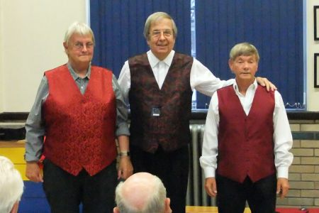 59.John Kelsall, Trevor Wilford and Allan Smith modeling potential new Dress Waistcoats for the Choristers