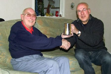 66.Denver Simmons receiving an engraved Tankard from Dave Jones (Chairman) to commemorate his 50 years of Choir Membership - 29th November.