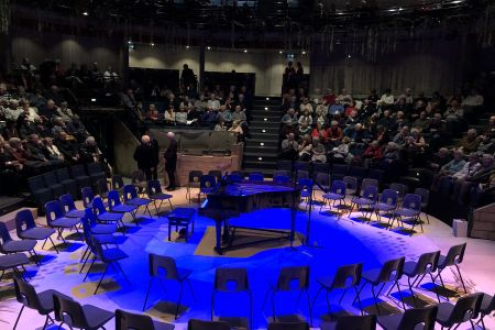 81. Audience arriving and taking their place at the New Vic theatre ready for out annual Christmas concert