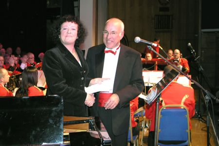 55.Liz Edwards collecting a cheque for £500 from the Choir at the