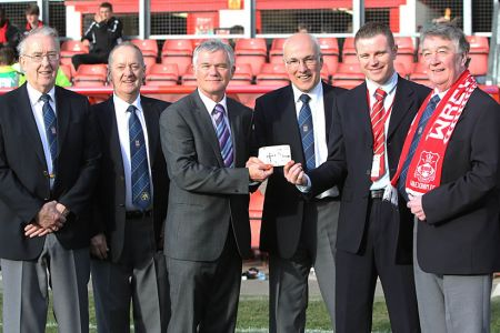 10.The Wrexham Supporters Trust present £3,000, the proceeds of the Fron Choir Concert in the William Aston Hall to Wrexham F.C. at the Wrexham V Barrow match at the Racecourse - 10th March