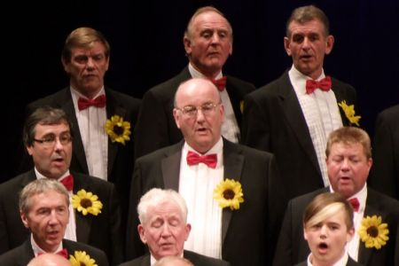 53.Howard Bourne (centre) joins the 2nd Tenor section as a full member at the Ulverston Concert.