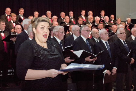 Leigh and the two choirs singing The Blessing