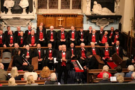15B. Choir Compere David Jones addressed the sell out audience at St Mary's Church Chirk at a concert in aid of the NSPCC 26.09.19