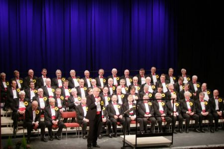 55.Dave Jones entertains the Ulverston audience with his Dai and Gwen stories as he introduces the Choir's performances.