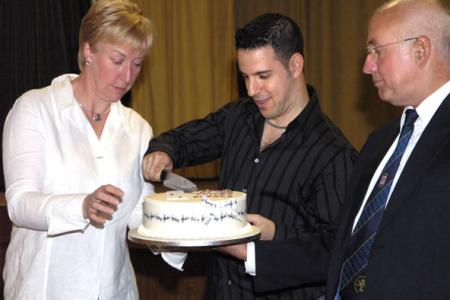 Ann Atkinson, Jon Cohen and David Jones tackle the Encore Celebration Cake