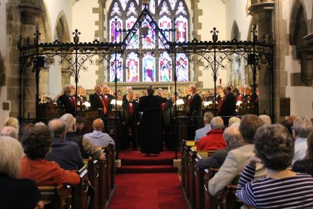 12C. The choir performing in Llangollen in aid of the Tower appeal