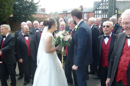 09C. The choir members offer their congratulations and some words of advice on married life to the newly weds