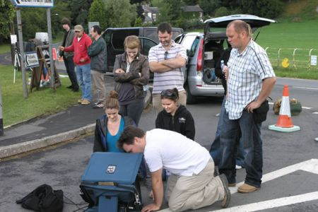 The production team from Peacock Design viewing the camera monitor.