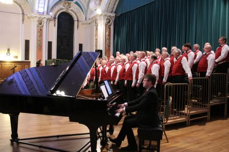 08E. Jason Ellis plays on the grand piano during the second half of the charity concert in Stockport town hall in aid of motor neurones disease and parkinson's disease.