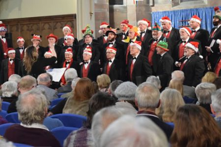 On stage, resplendent in Christmas Hats at Holy Trinity Church in Oswestry.