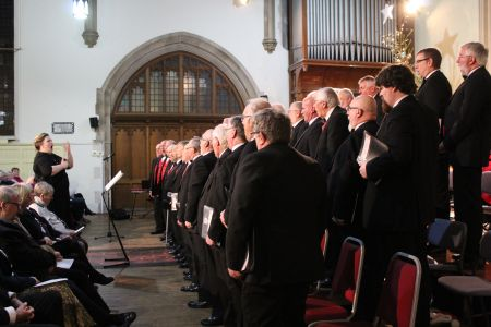 80. The choir assemble on stage after processing in performing torches