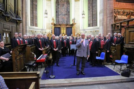 07I. Our Host for the evening Peter Williams addresses the Audience at St Alkmunds Church 23/03/19 credit David Hewitt
