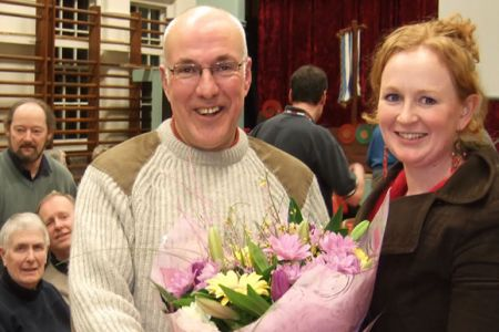 04.Dave (Chairman) presenting Caroline (Accompanist) with card, flowers and the Choir's best wishes for her wedding on Saturday the 21st of February