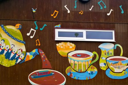 32.Mural on the Froncysyllte Community Centre. The Choir is represented on the Tea Pot.
