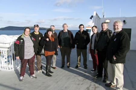 Stephanie, Rod, Liz, Barry, John, Jeremy, Ian, Jeff and Jon on the afterdeck of the Jonathan Swift in glorious sunshine watching Dublin Port disappearing into the distance