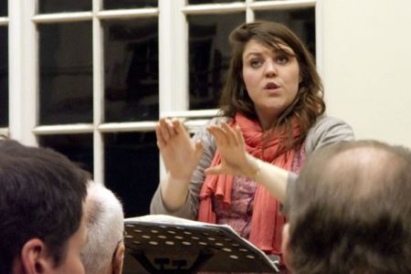 10.Leigh at her first practice puts the choir through its paces.
