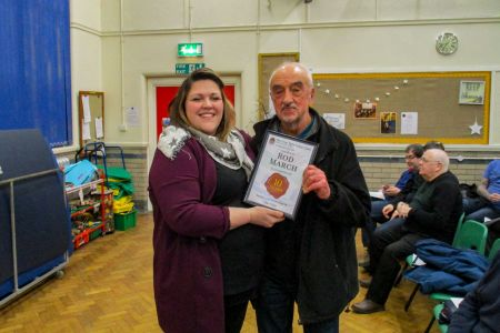 01D. Rod March receives his ten year service award from Leigh Mason the choirs  Musical Director at the AGM 31/01/2019