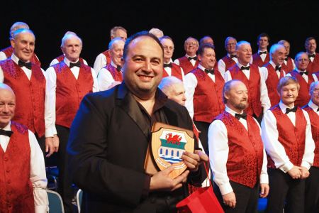 82.Presenting Wynne Evans with a memento of his three  concerts with us