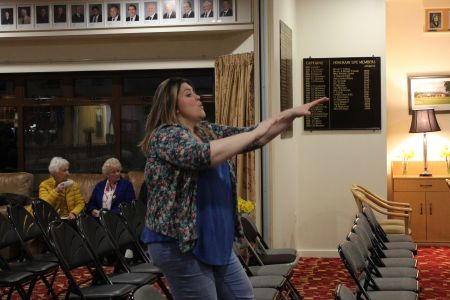 05A. Leigh warms up the choirs ready for tonights performance at Oswestry golf club 02/03/19