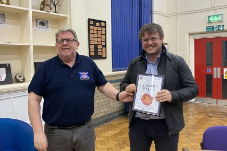 02h Jason Ellis receives his award for ten years service at the choirs accompanist from chairman Dave T Jones