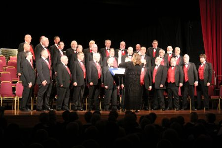 2a. The choir perform on stage at Elgin Town hall as part of the choirs 2019 mini tour of Scotland