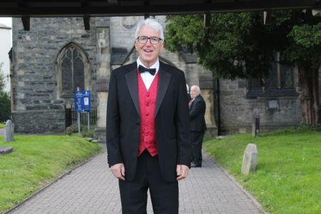 12D. The choir welcomes Ken Benbow as a full member of the choir as he makes his Debut in Llangollen