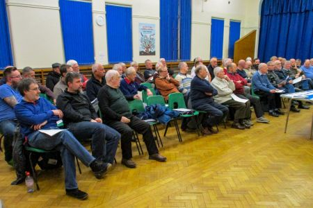 01B. The choir listens intently to the items on the agenda at the AGM 31/01/2019