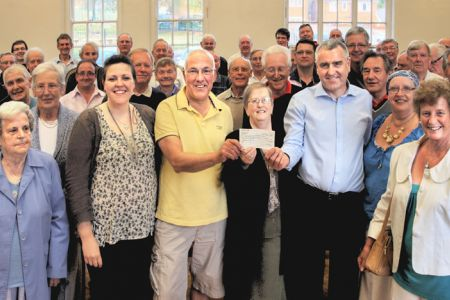 The Choir presenting a cheque for £2,700 to the National Eisteddfod of Wales - the proceeds of the St David's Day Concert. Receiving it are Bethan Grey-Davies, Chairman of the Trevor, Cefn and Fron Appeal Committee and Medwyn Edwards, Chairman of the Wrex