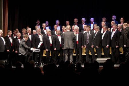 22.Mayor's Concert in Llangollen Town Hall. The Choir were joined on stage by a former chorister - Rhys Hughes - to sing Gwahoddiad. The concert raise £3,000 for local organisations and charities.