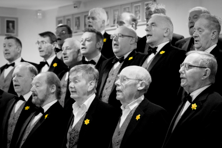 05B. The choir warm up for their St Davids Day concert at Oswestry Golf Club
