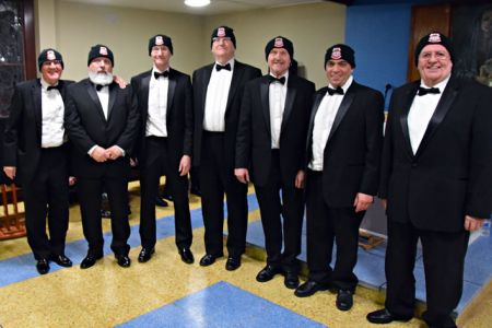 Phil, Roger, Richard, Howard, Colin, Gareth and Merfyn A fine body of men in their Choir Beanie Hats