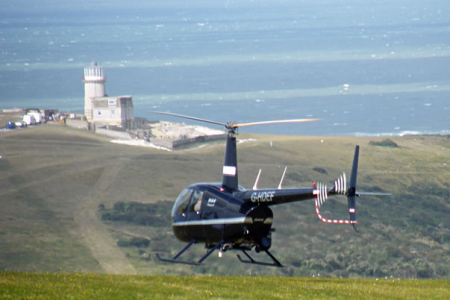 The winds eventually subside, as forecast, and the Helicopter is able to take off to film the aerial sequence in the advertisement trailer.