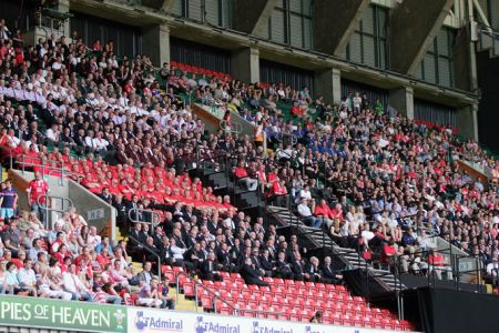 The massed choirs ready to perform for the match crowd.
