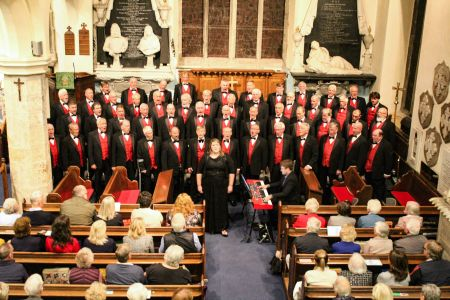 15D. Leigh Mason the choirs musical director performs the world in union for a very appreciative sell out audience at St Mary's Chirk.