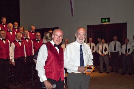 A presentation to the Chairman of the Highland Gospel Choir